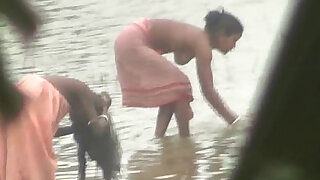 Indian women bathing by the river - duration 3:00