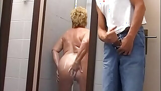 Mature chubby woman attacked and fucked in the gym shower - duration 20:00