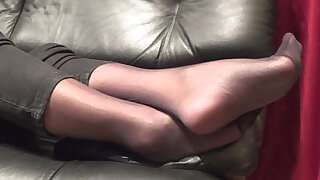 Stockinged footplay by mom - duration 0:16