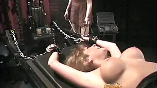Luscious blonde tart likes having her pussy pleasured in the dungeon - duration 20:00